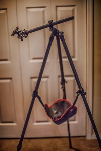 This Oben Tripod features a lateral swlng arm and a tripod hammock to easily add a stabilizing weight to the unit.