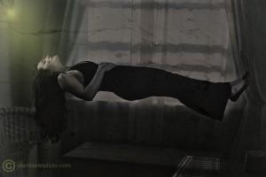 www.alantowerphoto.com Spokane Photographer AlanTower Woman levitating by window in reclining position.