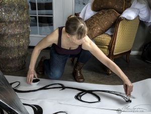 Here Julie is applying paint to the banners prior to our hanging them. Note she used 2-3 brushes at a time.