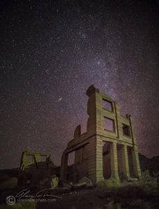 Rhyolite Ghost town near Death Valley. A very dark area, but one streetlight down the road is enough to illuminate the old ruins.