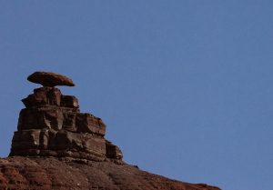 Mexican Hat in UT. Photo with plain blue sky, poor lighting.