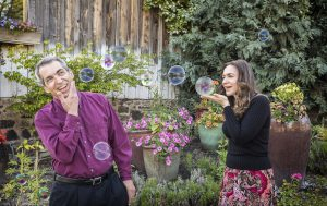 Composite image showing bubbles traveling across to kiss the groom.